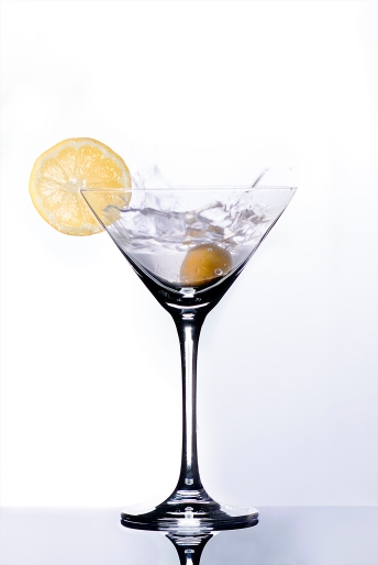 splashing martini with lemon and olive