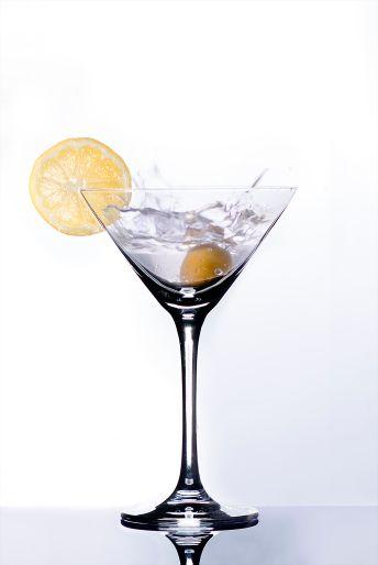 splashing martini with lemon and olive