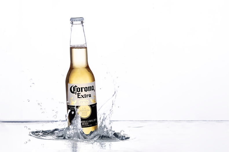 corona beer with waves and white background