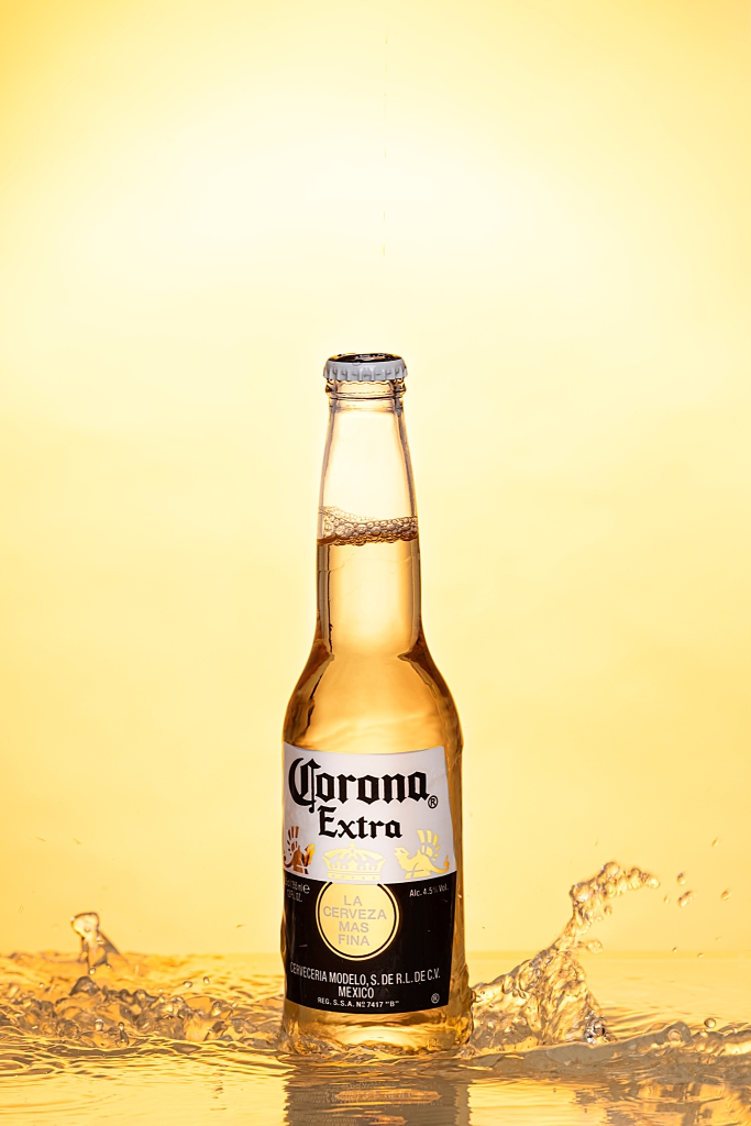 corona beer with waves and yellow background