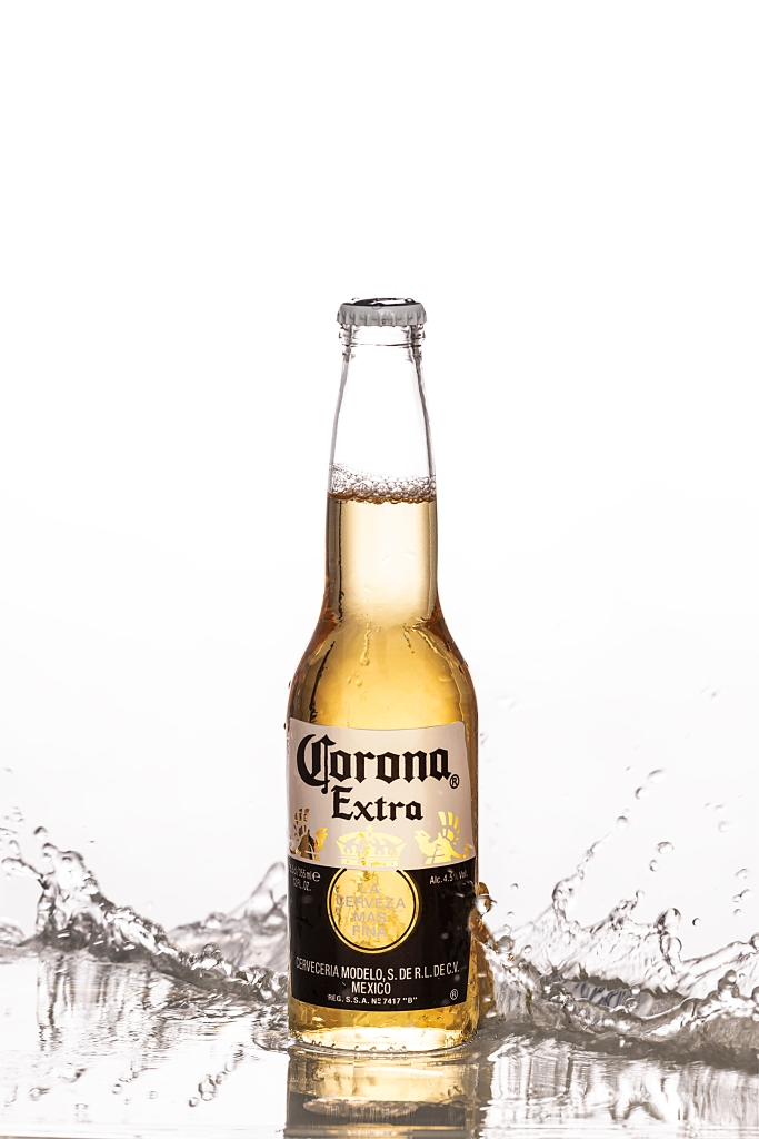 corona beer with splashes and white background